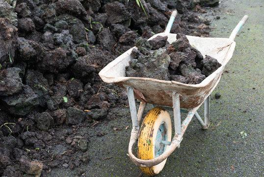 Old, painted wheelbarrow full of rocks