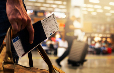 Boarding Pass Close Up In Crowded Airport Terminal