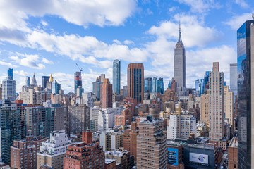New York City Midtown Skyline with Empire State in daytime, aerial photography  Fotobehang