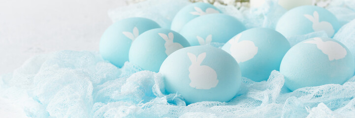 Easter banner. Holiday. Light white background, gentle pastel colors. Blue eggs