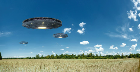 Photo sur Aluminium UFO UFO, an alien plate hovering over the field, hovering motionless in the air. Unidentified flying object, alien invasion, extraterrestrial life, space travel, humanoid spaceship. mixed medium