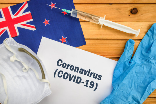 Coronavirus in New Zealand. Flag of New Zealand, vaccine, face mask for virus, glove and paper sheet with words Coronavirus COVID-19