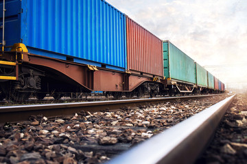 Train wagons carrying cargo containers for shipping companies. Distribution and freight transportation using railroads. Wall mural