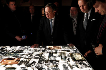 German politician Armin Laschet, Minister-President of Nordrhein-Westphalen, looks a pictures as he views an exhibition during his visit at Yad Vashem World Holocaust Remembrance Center in Jerusalem