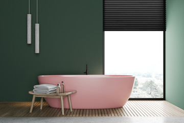 Green bathroom interior with pink tub