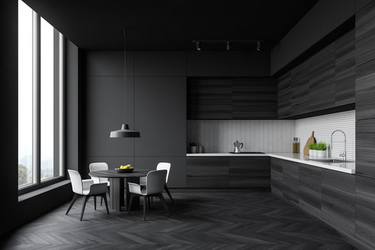 Grey and wooden kitchen with round table