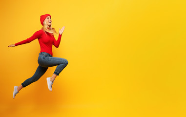 Girl runs fast. concept of energy and vitality.yellow background