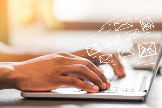 Online communication. African American man typing and sending e-mails in office, design with envelope icons
