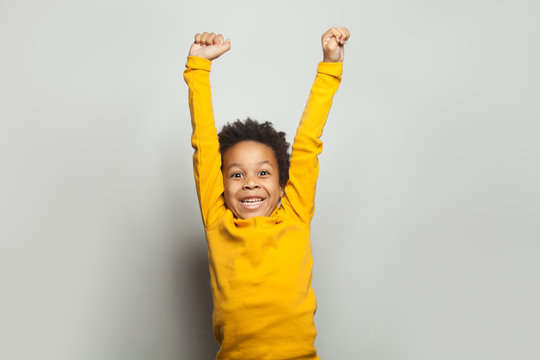 Little black child win-win! Kid boy having fun on white background