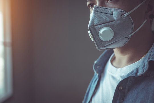 Man wearing a mask to protect against Coronavirus or Covid-19 virus And to prevent dust PM 2.5