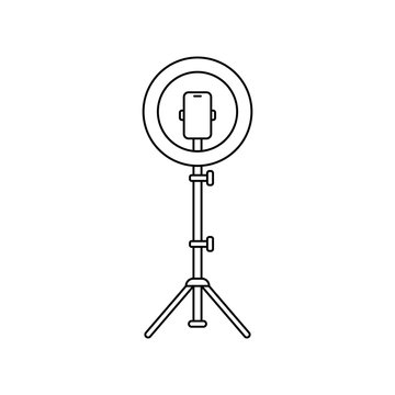 Led ring lamp on tripod with smartphone. Linear icon. Black simple illustration of light for selfie, blogger. Contour isolated vector image on white background