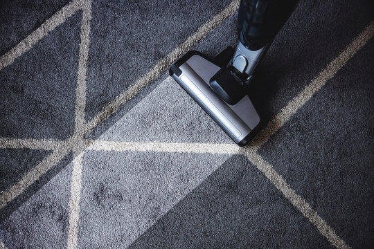 Close up of steam cleaner cleaning very dirty carpet.
