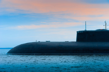 Submarine close-up. Submarine on the background of the evening sky. Fleet. Military conflicts at sea. Navy. Protection of water borders. Nuclear submarine.