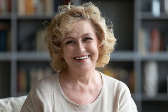 Portrait of happy mature woman relaxing at home