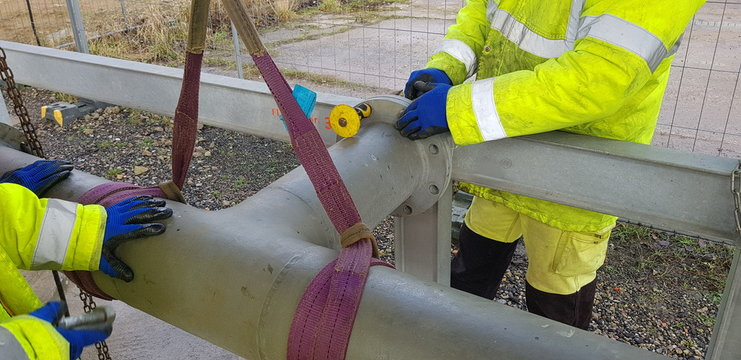 riggers move the pipe with two chain blocks and attach the flange with bolts
