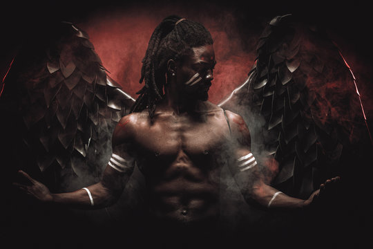 black angel suppresses a demon within every living being, african muscular man became dark angel after death, now he has big magnificent wings on back and can fly above the ground