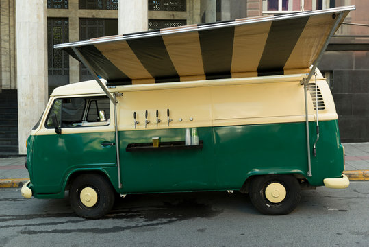 Isolated food truck of beer taps in a vintage green and beige van