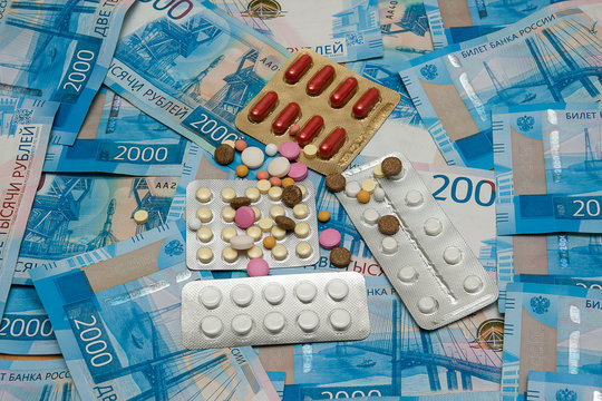 Various medicines is on the background of banknotes of the Bank of Russia