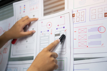 woman design engineer for ux architect template framework layout developer project mobile application on wall paper work in office with pen. Planning of development in program website interface ideas