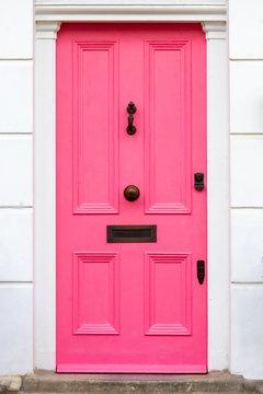 Stylish pink wooden front door