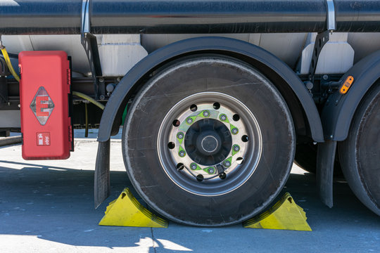 Tanker truck wheel with chocks placed for safety