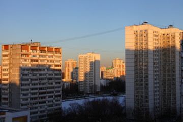 Fototapeta Moscow district of Konkovo, multi-storey residential buildings at winter evening with shadows from sun light