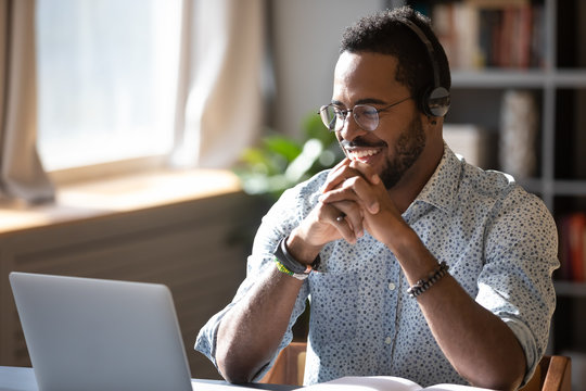 Smiling biracial businessman holding video call with clients partners.