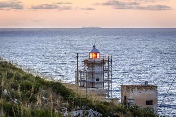 Tyrrhenian Sea lighthouse on Zafferano headland in Santa Flavia commune on the Sicily Island, Italy Fotobehang