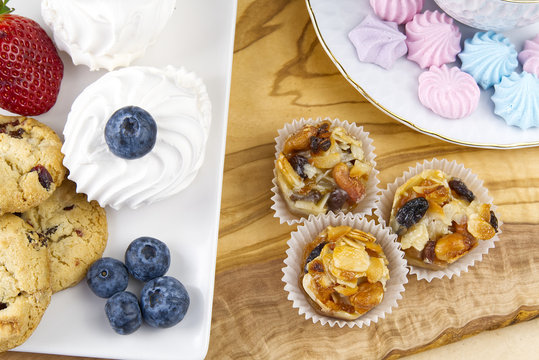 Oat cookies with Strawberry and bize cookies with blueberry on olive wood board