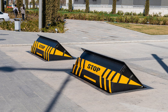 Two raisable road blockers for preventing of cars enter