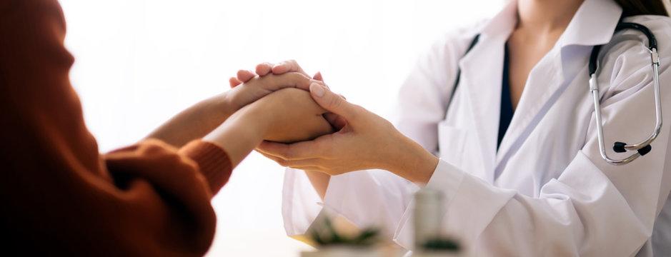 Doctor holding hands of patient  encouragement support cheering concept