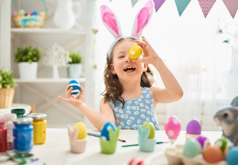 child painting eggs