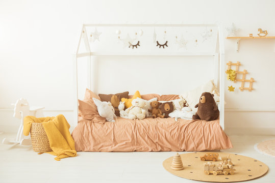 Interior of the children's room. Soft bed and lots of toys