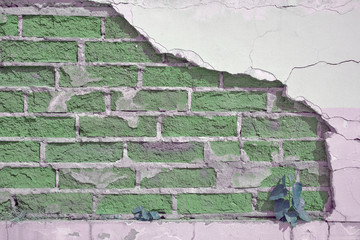 Green brick wall texture with sprouting grass, green brick background