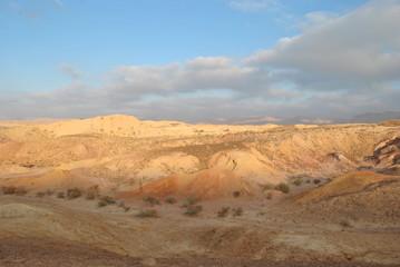Papiers peints Desert de sable Desert landscape at sunrise. Hiking desert part of Israel National Trail. Negev desert . Valley. Colorful sands