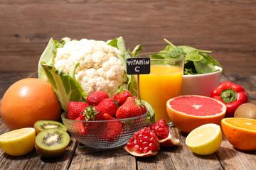 assorted of food high in vitamin c - spinach, strawberry, kiwi, orange, cauliflower