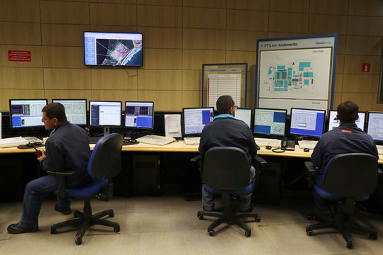 Workers are pictured in a control room at a chlorine-soda plant of the petrochemical company Braskem in Maceio