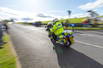 British police motorcycle traveling at high speed with motion blur