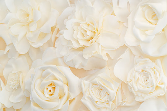 Artificial white rose buds for background and design