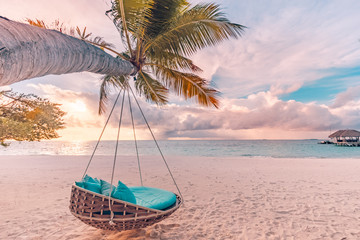 Tropical beach sunset as summer landscape with luxury resort beach swing or hammock and white sand and calm sea for sunset beach landscape. Tranquil beach scenery vacation and summer holiday concept. Fototapete