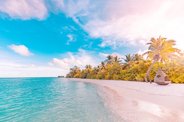 Tranquil tropical beach landscape. Relaxing sunset colors. Beautiful sunset over the sea with a...