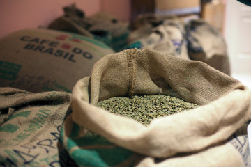 Khabarovsk, RUSSIA - JULY 27, 2013: Green coffee beans in a sack at coffee roasters storage