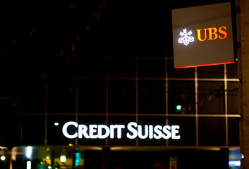 Logos of Swiss banks UBS and Credit Suisse are seen in Basel