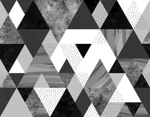 Seamless geometric abstract pattern with black, spotted and gray watercolor triangles on white background