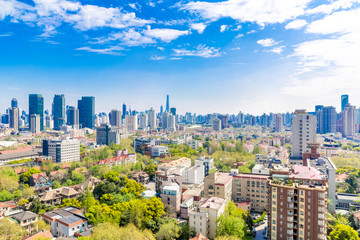 Foto auf Leinwand Shanghai Shanghai, China - Apr 9, 2015: Blue & green Shanghai: Clean, blue sky with clouds and many trees between residential buildings. In the distance the Shanghai Skyline. A different view on the metropolis