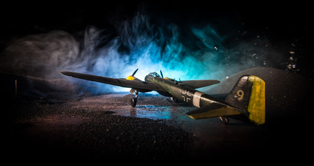 German Junker (Ju-88) night bomber at night. Artwork decoration with scale model of jet-propelled plane in possession.