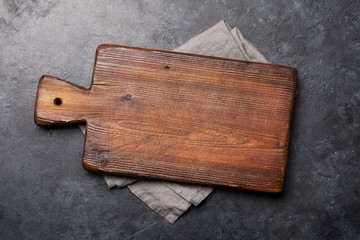 Cutting board over towel on stone kitchen table