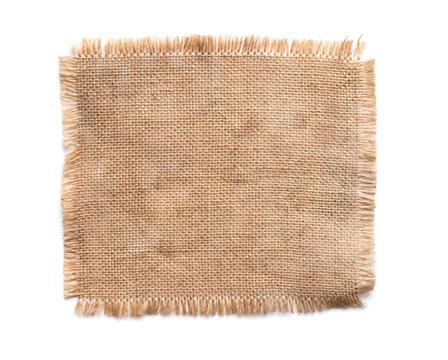 Old burlap fabric napkin, sackcloth piece isolated on white background