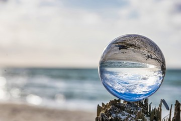 lensball at the beach - look through a lensball at the baltic sea - photography accessories