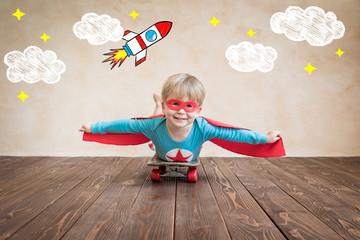 Superhero child on the skateboard
